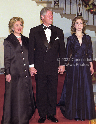 The First Family descends the Grand Staircase to meet their guests at the White House Millennium dinner in Washington, D.C. on December 31, 1999. (L-R) First Lady Hillary Rodham Clinton, United States President Bill Clinton, Chelsea Clinton.<br /> Credit: Ron Sachs / CNP