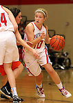 SIOUX FALLS, SD - JANUARY 22:  Darby Hugunin #10 from Lincoln drives past Hannah Nieman #24 from Washington in the first half of their game Tuesday night at Lincoln. (Photo by Dave Eggen/Inertia)