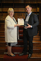 Raman Husejni (R) receives his certificate at the Citizenship Ceremony at Carmarthen Register Office, Carmarthenshire, Wales, UK. Monday 22 August 2016