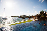 BERMUDA. The Infinity Pool at the Hamilton Princess & Beach Club Hotel. The Hamilton Harbour can be seen in the background.