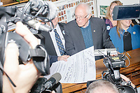 Surrounded by media, Democratic presidential candidate and Vermont senator Bernie Sanders files the required paperwork and pays the $1000 filing fee to be on the 2020 Democratic presidential ballot in the NH Secretary of State's Office in the NH State House in Concord, New Hampshire, on Thu., October 31, 2019. As part of the filing process, Sanders signed a ceremonial primary ballot that is signed by all candidates in the race. Sanders was accompanied during the process by his wife Jane O'Meara Sanders.
