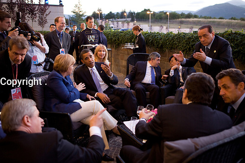 President Barack Obama confers with world leaders, Canadian Prime Minister Stephen Harper, German Chancellor Angela Merkel, British Prime Minister Gordon Brown, Japanese Prime Minister Taro Aso, Italian Prime Minister Silvio Berlusconi, and French President Nicolas Sarkozy, while attending the G-8 summit in L'Aquila, Italy, July 8, 2009. <br /> (Official White House Photo by Pete Souza)<br /> <br /> This official White House photograph is being made available for publication by news organizations and/or for personal use printing by the subject(s) of the photograph. The photograph may not be manipulated in any way or used in materials, advertisements, products, or promotions that in any way suggest approval or endorsement of the President, the First Family, or the White House.