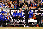 16 October 2004: Wizards head coach Bob Gansler (center, standing) watches the game. Seated on the bench from the left are goalkeepers Tony Meola and Will Hesmer and coaches Tim Mulqueen and Brian Bliss. Trainer Chet North stands at the right. The Kansas City Wizards defeated the Los Angeles Galaxy 1-0 at Arrowhead Stadium in Kansas City, MO in a regular season Major League Soccer game..