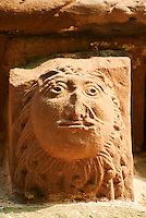 Norman Romanesque exterior corbel no 14 - sculpture of a head, half man half lion. The Norman Romanesque Church of St Mary and St David, Kilpeck Herefordshire, England. Built around 1140