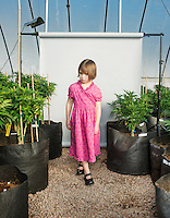Charlotte Figi (cq, age 7) in a grow house of Charlotte's Web marijuana plants near Colorado Springs, Colorado, Thursday, February 6, 2013. Charlotte suffered from over 100 seizure like symptoms and epilepsy before discovering a strain of marijuana that would stop her seizures. <br /> <br /> Photo by Matt Nager