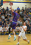 Spanish Springs Cougars Josh Prizina drives past Reed Raiders Lincoln Turner fora lay-up in their basketball game played on Friday night, February 10, 2017 at Reed High School in Sparks, Nevada.