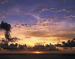"""June 24th, 2011, Ogasawara Islands, Japan - The sun sets over the horizon of Japan's Ogasawara Islands in this undated file photo. The Ogasawara Islands, some 1,000 km south of Tokyo, was added to UNESCO's list of World Natural Heritage sites, becoming the Japan's fourth site to receive the designation on Friday, June 24, 2011. The chain of about 30 islands, dubbed the """"Galapagos of the Orient"""" for their unique wildlife, including an endangered bat species known as the Bonin flying fox and the black-footed albatross. (Photo by Naho Yoshizawa/AFLO) [1140] -mis-"""