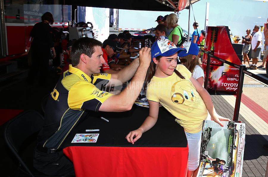 Jun. 1, 2013; Englishtown, NJ, USA: NHRA top fuel dragster driver Morgan Lucas signs autographs during qualifying for the Summer Nationals at Raceway Park. Mandatory Credit: Mark J. Rebilas-