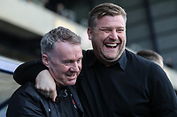 John Sheridan (Manager) of Fleetwood Town with Karl Robinson (Manager) of Oxford United during the Sky Bet League 1 match between Oxford United and Fleetwood Town at the Kassam Stadium, Oxford, England on 10 April 2018. Photo by David Horn.