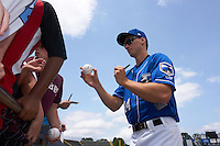 Biloxi Shuckers pitcher Brent Suter (24) signs autographs before a game against the Birmingham Barons on May 24, 2015 at Joe Davis Stadium in Huntsville, Alabama.  Birmingham defeated Biloxi 6-4 as the Shuckers are playing all games on the road, or neutral sites like their former home in Huntsville, until the teams new stadium is completed in early June.  (Mike Janes/Four Seam Images)