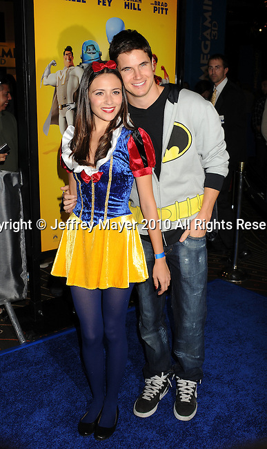 "HOLLYWOOD, CA. - October 30: Italia Ricci and Robbie Amell arrive at the ""Megamind"" Los Angeles Premiere at Mann Chinese 6 on October 30, 2010 in Los Angeles, California."