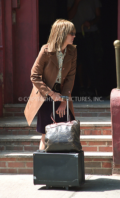 "Meg Ryan on the set of her latest film ""In the Cut."" East Village, New York, July 24, 2002. Please byline: Alecsey Boldeskul/NY Photo Press.   ..*PAY-PER-USE*      ....NY Photo Press:  ..phone (646) 267-6913;   ..e-mail: info@nyphotopress.com"