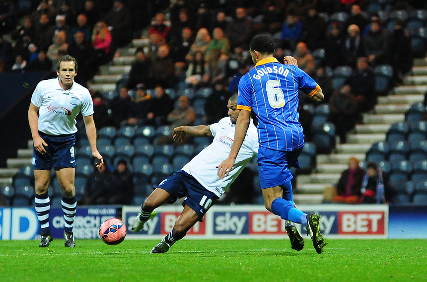 Preston North End&rsquo;s Jermaine Beckford looks to get a shot in at goal under pressure from Shrewsbury Town's Connor Goldson<br /> <br /> Photographer Chris Vaughan/CameraSport<br /> <br /> Football - FA Challenge Cup Second Round - Preston North End v Shrewsbury Town - Saturday 6th December 2014 - Deepdale - Preston<br /> <br />  &copy; CameraSport - 43 Linden Ave. Countesthorpe. Leicester. England. LE8 5PG - Tel: +44 (0) 116 277 4147 - admin@camerasport.com - www.camerasport.com