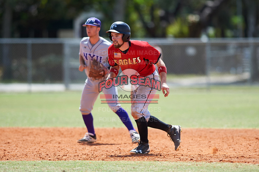 Edgewood College Eagles Jonathan Roehler (9) leads off second base in front of shortstop Trevor Francesconi (7) during a game against the New York University Violets on March 14, 2017 at Terry Park in Fort Myers, Florida.  NYU defeated Edgewood 12-7.  (Mike Janes/Four Seam Images)