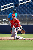 Washington Nationals first baseman Drew Mendoza (13) stretches for a throw during an Instructional League game against the Miami Marlins on September 26, 2019 at FITTEAM Ballpark of The Palm Beaches in Palm Beach, Florida.  (Mike Janes/Four Seam Images)