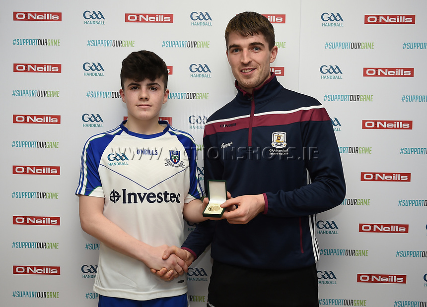 19/03/2018; 40x20 All Ireland Juvenile Championships Finals 2018; Kingscourt, Co Cavan;<br /> Boys Under-16 Singles; Wexford (Josh Kavanagh) v Monaghan (Eoghan McGinnity)<br /> Winner Eoghan McGinnity receives his winners medal from Martin Mulkerrins<br /> Photo Credit: actionshots.ie/Tommy Grealy