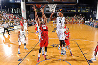 21 January 2012:  FIU guard-forward Dominique Ferguson (3), center Brandon Moore (22) and FAU guard-forward Jordan McCoy (21) pursue a rebound in the first half as the Florida Atlantic University Owls defeated the FIU Golden Panthers, 66-64, at the U.S. Century Bank Arena in Miami, Florida.