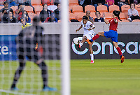 HOUSTON, TX - FEBRUARY 03: Jess McDonald #14 of the United States crosses the ball past Carol Sanchez #6 of Costa Rica during a game between Costa Rica and USWNT at BBVA Stadium on February 03, 2020 in Houston, Texas.