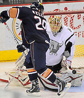 San Antonio Rampage goaltender Jacob Markstrom, right, makes a save on Oklahoma City Barons' Ryan Keller during the third period of an AHL hockey game, Monday, May 7, 2012, in San Antonio. Oklahoma City won 2-1 in overtime. (Darren Abate/pressphotointl.com)
