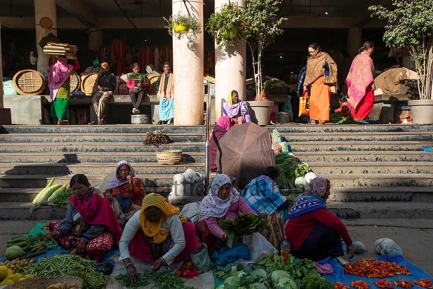 India - Manipur - Imphal - Illegal sellers are allowed to sell in the streets only in the early hours of the morning. Most of them hang around the whole day and are regularly kicked out by the police and chased by authorized vendors.