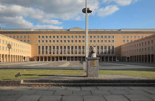 Buildings of the former Tempelhof International Airport, at Eagle Square, built 1920s and 1930s, Platz der Luftbrucke, Berlin, Germany. In the foreground is the Eagle Head sculpture, 1940, by Wilhelm Lemke, based on a design by Ernst Sagebiel, which originally stood on top of the Tempelhof building. Tempelhof is now a public park. Picture by Manuel Cohen