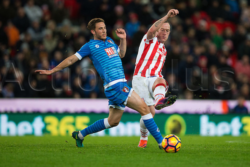 19.11.2016. Bet365 Stadium, Stoke, England. Premier League Football. Stoke City versus AFC Bournemouth. Stoke City midfielder Charlie Adam avoids a tackle by Bournemouth midfielder Dan Gosling.