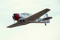 Photo of a North American AT-6 Fighter Trainer WW2 airplane in Flight.