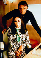 BNPS.co.uk (01202 558833)<br /> Pic: Juliens/BNPS<br /> <br /> 1972 picture of Taylor and Burton on the set of Zee & Co.<br /> <br /> A spectacular collection of over 1,000 items charting Elizabeth Taylor's life including her iconic outfits are up for sale for over £1million. ($1.25million)<br /> <br /> Dozens of designer gowns, fur coats and capes are being auctioned by the trustees of the estate of the late English actress.<br /> <br /> Also going under the hammer are the Hollywood icon's stylish wigs, scarves, shoes and jewellery.<br /> <br /> Items of her lavish furniture from her luxury homes across the world, right down to her personalised salt and pepper shaker, are included.