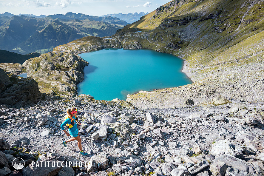 Trail running above the turquoise water of the Schottensee, below the Pizol, Switzerland