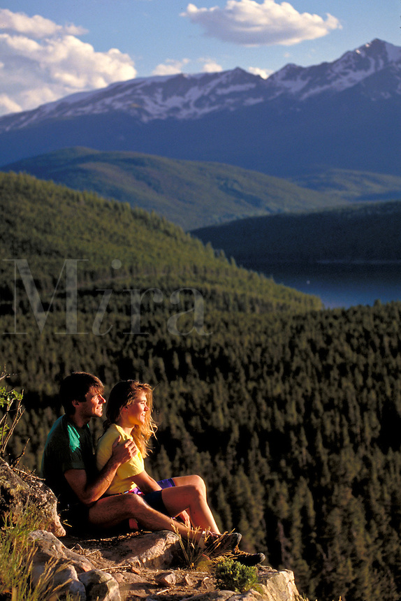 Couple enjoying scenic view at sunset.