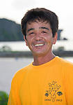 Fisherman Munekazu Mekaru, who set into motion a coral reef restoration project, stands on the municipal beach at Onna Village, Okinawa Prefecture, Japan, on Saturday, June 23, 2012. Photographer: Robert Gilhooly