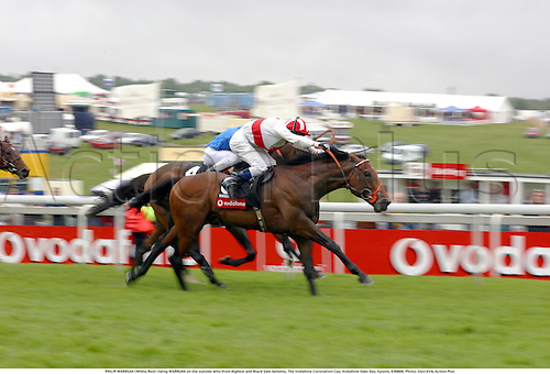 PHILIP WARRSAN (White/Red) riding WARRSAN on the outside wins from Highest and Black Sam bellamy, The Vodafone Coronation Cup, Vodafone Oaks Day, Epsom, 030606. Photo: Glyn Kirk/Action Plus...2003.horses horse racing.winner winners..