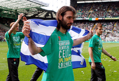 21.04.2013 Glasgow, Scotland. Georgios Samaras is draped in the Greek flag during the lap of honour after the Scottish Premier League game between Celtic and Inverness Caledonian Thistle from Celtic Park.