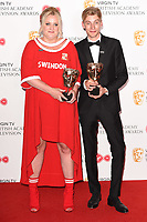 Daisy May and Charlie Cooper<br /> in the winners room for the BAFTA TV Awards 2018 at the Royal Festival Hall, London<br /> <br /> ©Ash Knotek  D3401  13/05/2018
