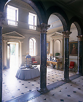 The Palladian two-storey entrance hall has a painted ceiling by William Kent