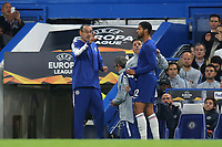 Chelsea's Ruben Loftus-Cheek walks over to change his torn shirt much to the surprise of Chelsea Manager, Maurizio Sarri and Gianfranco Zola who both seem anxious that he has left the field of play while the game is still going on during Chelsea vs MOL Vidi, UEFA Europa League Football at Stamford Bridge on 4th October 2018