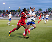 Cat Whitehill (4) of the Boston Breakers tries to keep pace with Tiffany McCarty (14) of the Washington Spirit during the game at the Maryland SoccerPlex in Boyds, MD.  Washington tied Boston, 1-1.
