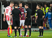 Andy Carroll of West Ham United has words with Referee Michael Oliver at full time during the Premier League match between West Ham United and Stoke City at the Olympic Park, London, England on 16 April 2018. Photo by Andy Rowland.