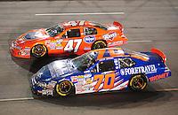 May 1, 2009; Richmond, VA, USA; NASCAR Nationwide Series driver Shelby Howard (70) races alongside Michael McDowell (47) during the Lipton Tea 250 at the Richmond International Raceway. Mandatory Credit: Mark J. Rebilas-