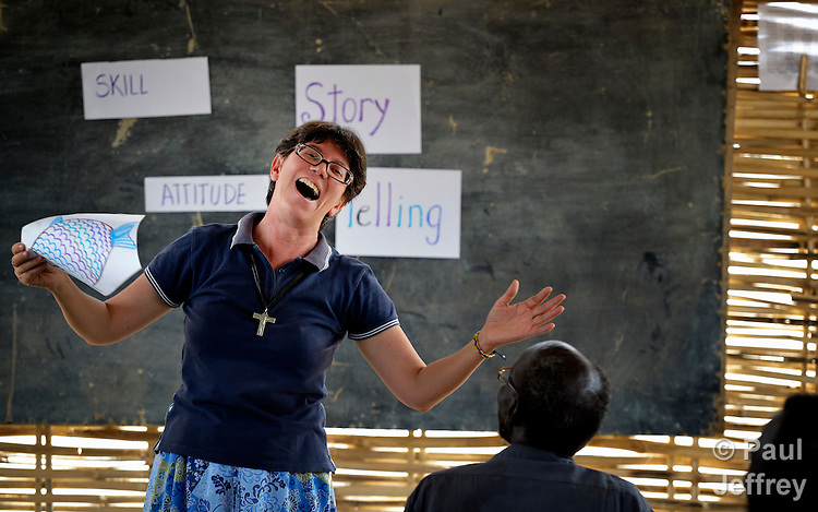Sister Sandra Amado, a Comboni sister from Brazil, laughs as she teaches a class at a teacher training course in Agok, a town in the contested border region of Abyei between Sudan and South Sudan. Sister Amado is a volunteer with Solidarity with South Sudan, an international network of Catholic groups providing training for teachers, health care workers, and pastoral agents in South Sudan. The teachers she is teaching in Agok are among tens of thousands of people displaced in 2011 attacks by soldiers and militias from the northern Republic of Sudan.