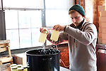 BROOKLYN, NY - February 27, 2014: Bottling Switchel, a folk drink made with vinegar, maple syrup and ginger. CREDIT: Clay Williams for Serious Eats.<br /> <br /> <br /> &copy; Clay Williams / http://claywilliamsphoto.com