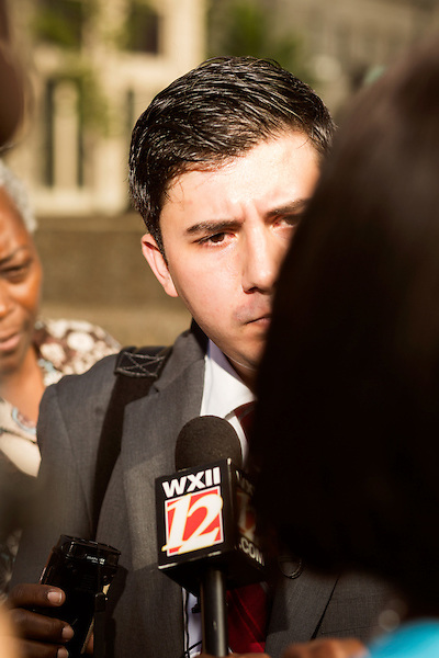 July 13, 2015. Winston Salem, North Carolina.<br />  Ricky Diaz, the spokesperson for the North Carolina Republican Party, was questioned by the press after he announced the initiation of the party's &quot;Immoral Mondays&quot; website. The site claims to expose the out of state funding of the Moral Monday events that have been popular with democratic voters over the last few years. <br />  A press conference was held outside the federal courthouse on the opening day of the North Carolina NAACP's case against Gov. Pat McCrory ( NC NAACP v. McCrory)<br />  The NC NAACP contests that HB 589 (Voter ID requirements) violate Section 2 of the Voting Rights Act (42 U.S.C. 1973) and the Fourteenth and Fifteenth Amendments of the Constitution.