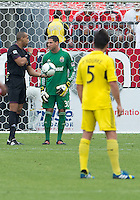July 20, 2013: Referee Ismail Elfath hands the ball to Columbus Crew goalkeeper Andy Gruenebaum #30 during a game between Toronto FC and the Columbus Crew at BMO Field in Toronto, Ontario Canada.<br /> Toronto FC won 2-1.