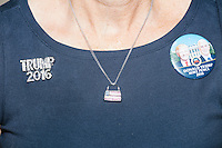 A woman wears pro-Trump pins and a patriotic necklace in the Palm Beach Republican Club and West Palm Beach Victory Headquarters office in West Palm Beach, Florida. The office serves as a place for volunteers to gather and organize for various Republican campaigns, including Donald Trump's general election campaign.