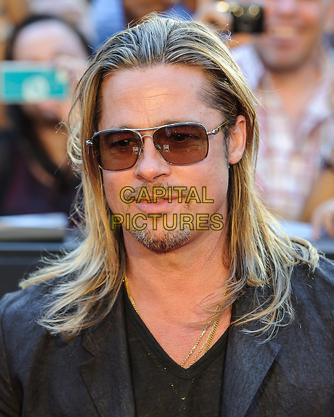 Brad Pitt<br /> New York premiere of 'World War Z'  in Times Square, New York, New York, USA.<br /> June 17th, 2013<br /> headshot portrait black suit sunglasses shades goatee facial hair   <br /> CAP/ADM/MSA<br /> &copy;Mario Santoro/AdMedia/Capital Pictures