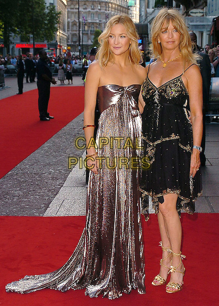 "KATE HUDSON & GOLDIE HAWN.At the UK Film Premiere of ""Skeleton Key"",.Vue West End Cinema, London, July 20th 2005..full length mother daughter family silver grey metallic strapless pleated shiny dress black beaded Matthew Williamson gold strappy sandals shoes.Ref: CAN.www.capitalpictures.com.sales@capitalpictures.com.©Can Nguyen/Capital Pictures"