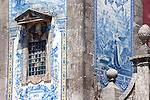 A detail of the tiles on the facade of Santo Ildegonson Church in Porto, Portugal.