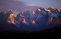 Sunset sweeps the peaks of Torres del Paine National Park in southern Chile.