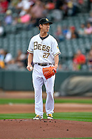 Salt Lake Bees starting pitcher Tim Lincecum (27) looks for the sign before delivering a pitch to the plate against the Round Rock Express in Pacific Coast League action at Smith's Ballpark on August 15, 2016 in Salt Lake City, Utah. Round Rock defeated Salt Lake 5-4.  (Stephen Smith/Four Seam Images)