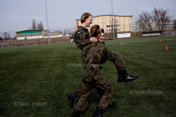RADOM, POLAND, 28/02/2017:<br /> At the XI Stanislaw Staszic Lycee in Radom, schoolboys and schoolgirls from special classes with military orientation are having a military lesson, during which they learn to drill, a fight, workout and shooting with a pnematic rifle. <br /> (Photo by Piotr Malecki / Napo Images)   <br /> ###<br /> RADOM, 28/02/2017:<br /> Cwiczenia klas mundurowych w XI LO im. Stanislawa Staszica w Radomiu. Klasy takie maja zarowno zwykle szkolne zajecia jak i wiele lekcji przygotowujacych uczniow do zawodow policjanta, zolnierza, lub sluzby w jednostkach obrony terytorialnej.<br /> Fot: Piotr Malecki / Napo Images<br /> <br /> ###ZDJECIE MOZE BYC UZYTE W KONTEKSCIE NIEOBRAZAJACYM OSOB PRZEDSTAWIONYCH NA FOTOGRAFII###